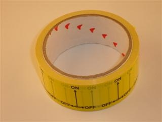 ARCTIC PH095B GAS ON/OFF TAPE 38MM X 33 METRES BLACK ON YELLOW